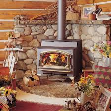 masonry heater takes only a few sticks of wood and heats for a