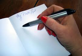 pen writing on paper digital journaling or pen and paper writing on the pages of life file2181243266489