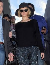chris martin and jennifer lawrence jennifer lawrence arrives at los angeles inernational airport