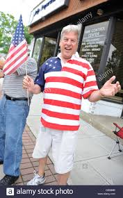 Design Of American Flag Man Wearing Shirt With American Flag Design Watches The Merrick