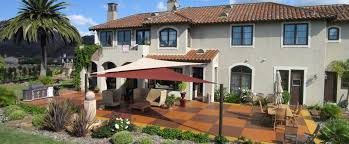 exterior modern shade sails design with long chairs and tile
