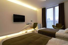 bedroom tv inspiration for a modern carpeted bedroom remodel in