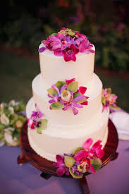 white tiered cake with amazing tropical flowers wedding cake