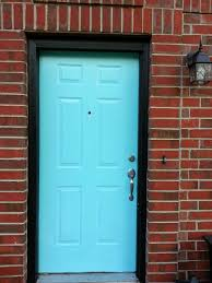 cheerful tiffany blue front door with black trim and red brick d