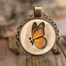 semicolon butterfly pendant the common store