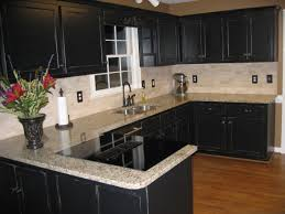 black kitchen painted faux black cabinets venetian gold granite