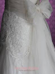 whimsical cross back organza v neck a line beach lace wedding gown
