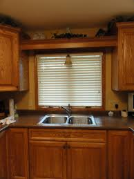 decorating sandy brown wooden kitchen cabinet with granite