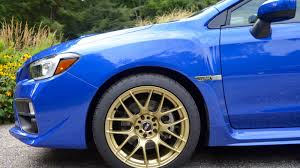 white subaru black rims world rally blue with gold wheels