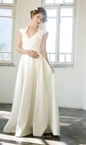 simple sleeveless floor length wedding dress with bolero jacket