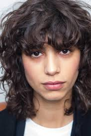 layered hairstyles with bangs and tuck behind the ears bangs hair guide inspirational looks and styling tips