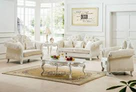 living room with white tufted antique sofas antique living room