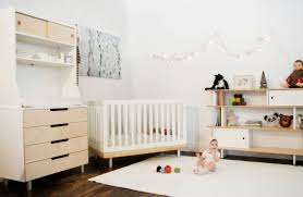 modern baby room decor with black cribs decorated green tapes
