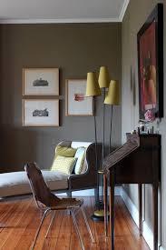 dark green grey walls with yellow lighting grey living room