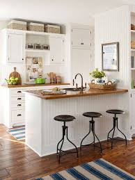 small open kitchen designs with white cabinets and butcher block
