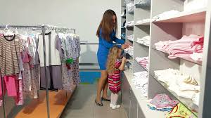 Little Girls Clothing Stores Mother And Little Daughter Shopping For Girls Clothes In A