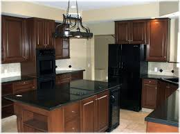 dark birch kitchen cabinets with shining white quartz counters and