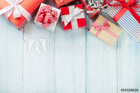 where can i buy christmas boxes christmas gift boxes on wooden table buy this stock photo and