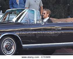 ryan gosling puts on a vintage suit for a scene in his new movie