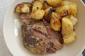 slow cooked leg of lamb with garlic lemon and rosemary and lemon