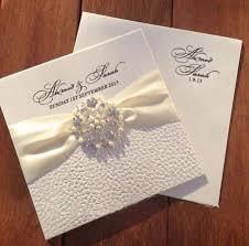 wedding invitations embossed white pebbles embossed wedding invitations