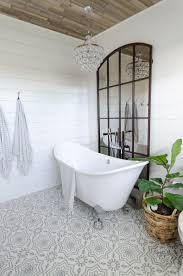beautiful urban farmhouse master bathroom remodel the plank ceiling shiplap walls grid mirror cement tile and raindrop chandelier provide a perfect backdrop for my double slipper tub
