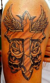 flowers and winged cross on right half sleeve