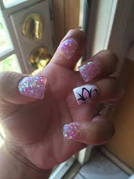 white french tip nail art with pink flower design white french