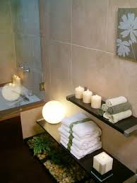 small spa bathroom ideas use low floating shelves to display candles and towels next to