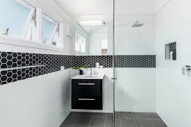 small and trendy bathroom design with cool black hexagonal border tiles