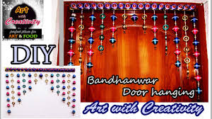 newspaper wall hanging bandhanwar door hanging toran art
