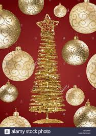up of gold ornaments and small tree stock photo