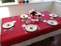 chic christmas table design with creamy cloths and gold red