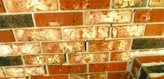 what causes stair step cracks in a block or brick wall