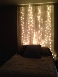 string lights behind sheer curtain headboard new bedroom ideas