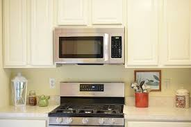 How To Paint White Kitchen Cabinets by How To Clean White Kitchen Cabinets
