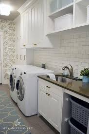 turquoise blue laundry room with gray striped rug contemporary