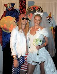 adam levine and anne vyalitsyna dressed up as a rock star wedding