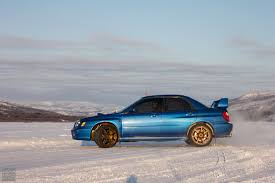 subaru drift car drifting on icy roads from norway to lapland