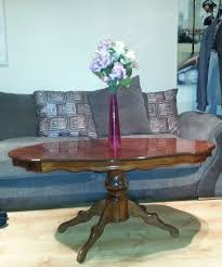 beautiful round hand carved wooden coffee table in basildon