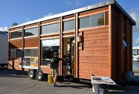 mobile tiny house a hit at tampa rv show tbo com escape traveller featured their revolutionary tiny portable homes and rvs at the florida state fairgrounds