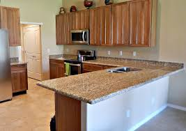 almond gold granite countertop remodel with half moon edge and