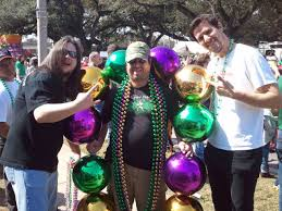 large mardi gras the planet 105 1 staff are out holding some mardi gras bulbs