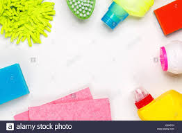 house cleaning products on white table stock photo royalty free