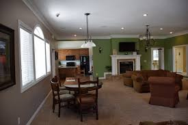 large lounge with fireplace and party kitchen the village apartments