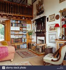traditional country study living room with mezzanine and fitted