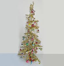 gold tinsel feather tree with assorted ornaments ebth