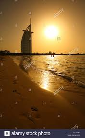 Burj Al Arab by Jumeirah Beach And Burj Al Arab Hotel At Sunset Dubai United