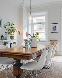 antique table with modern chairs interiorcrowd mismatched dining room vintage modern and design trends