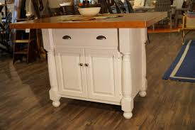 amish roseburg island with two drawers and two doors in stock cherry and maple wood french country kitchen island